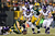Linebacker Clay Matthews #52 of the Green Bay Packers recovers a forced fumble in front of quarterback Joe Webb #14 of the Minnesota Vikings in the second half during the NFC Wild Card Playoff game at Lambeau Field on January 5, 2013 in Green Bay, Wisconsin.  (Photo by Andy Lyons/Getty Images)