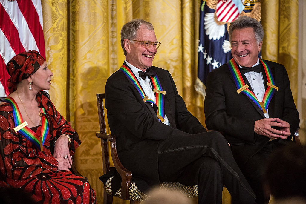 Description of . WASHINGTON - DECEMBER 2: (AFP OUT) Ballerina Natalia Makarova, Comedian David Letterman, and actor Dustin Hoffman (L-R) attend the Kennedy Center Honors reception at the White House on December 2, 2012 in Washington, DC. The Kennedy Center Honors recognized seven individuals - Buddy Guy, Dustin Hoffman, David Letterman, Natalia Makarova, John Paul Jones, Jimmy Page, and Robert Plant - for their lifetime contributions to American culture through the performing arts. (Photo by Brendan Hoffman/Getty Images)