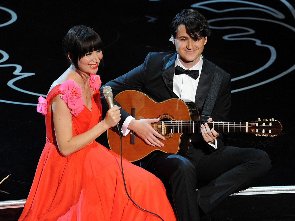 Description of . Singer Karen O and musician Ezra Koenig perform onstage during the Oscars at the Dolby Theatre on March 2, 2014 in Hollywood, California.  (Photo by Kevin Winter/Getty Images)