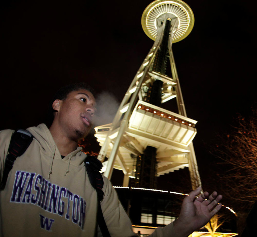 Description of . Andre Edwards smokes marijuana, Thursday, Dec. 6, 2012, just after midnight at the Space Needle in Seattle. Possession of marijuana became legal in Washington state at midnight, and several hundred people gathered at the Space Needle to smoke and celebrate the occasion, even though the new law does prohibit public use of marijuana. (AP Photo/Ted S. Warren)