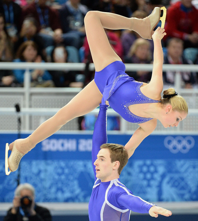 Description of . Ukraine's Julia Lavrentieva and Ukraine's Yuri Rudyk perform in the Figure Skating Pairs Short Program at the Iceberg Skating Palace during the 2014 Sochi Winter Olympics on February 11, 2014.   DAMIEN MEYER/AFP/Getty Images