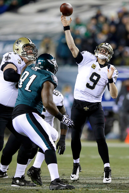 Description of . New Orleans Saints' Drew Brees (9) passes during the first half of an NFL wild-card playoff football game against the Philadelphia Eagles, Saturday, Jan. 4, 2014, in Philadelphia. (AP Photo/Michael Perez)