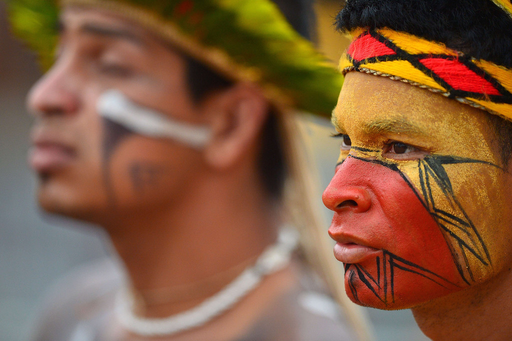 Description of . A Brazilian indigenous man of the Pataxo tribe waits to take part in the bow and arrow competition during the XII International Games of Indigenous Peoples in Cuiaba, Mato Grosso state, Brazil on November 12, 2013. AFP PHOTO / Christophe SIMON/AFP/Getty Images