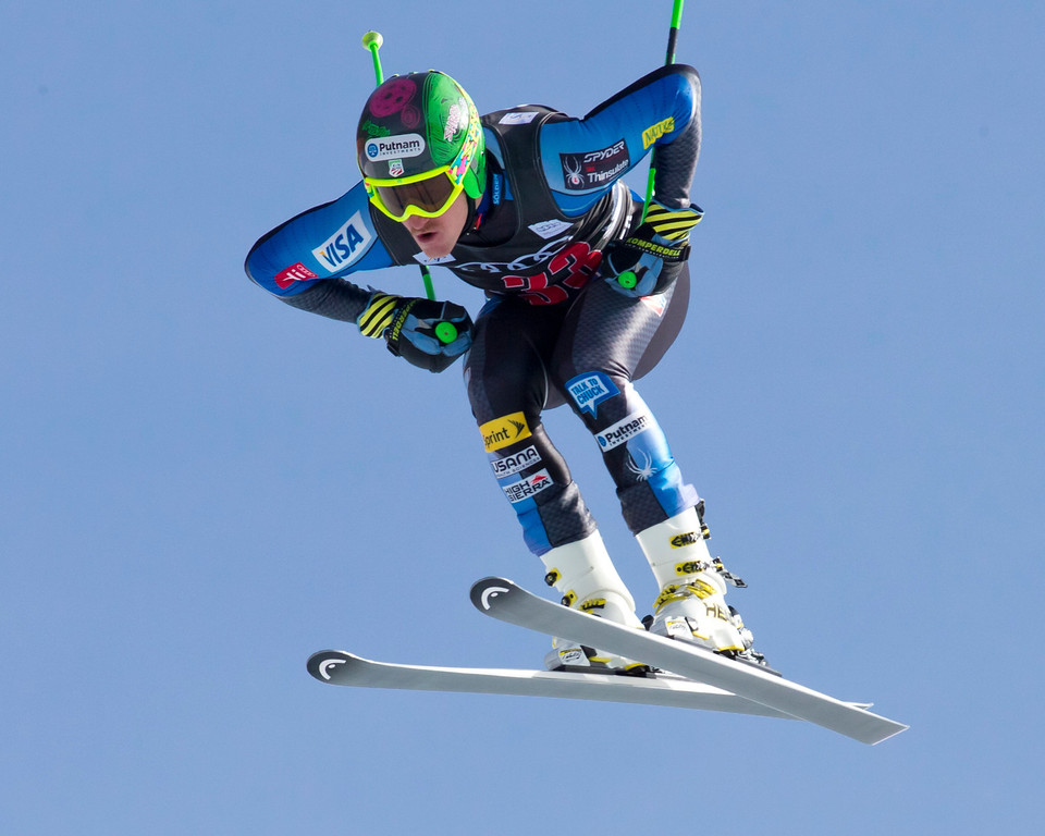 Description of . Ted Ligety of the United States, is airborne on the course during the men's World Cup downhill ski race in Beaver Creek, Colo., on Friday, Nov. 30, 2012. (AP Photo/Nathan Bilow)