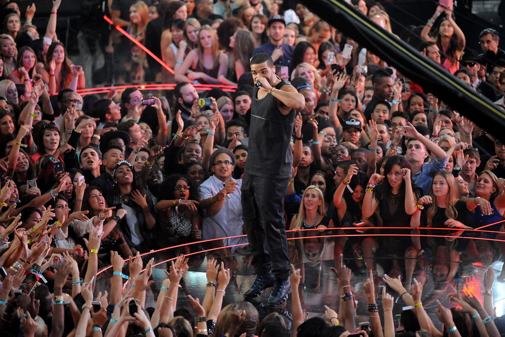 Description of . Drake performs at the MTV Video Music Awards on Sunday, Aug. 25, 2013, at the Barclays Center in the Brooklyn borough of New York. (Photo by Scott Gries/Invision/AP)