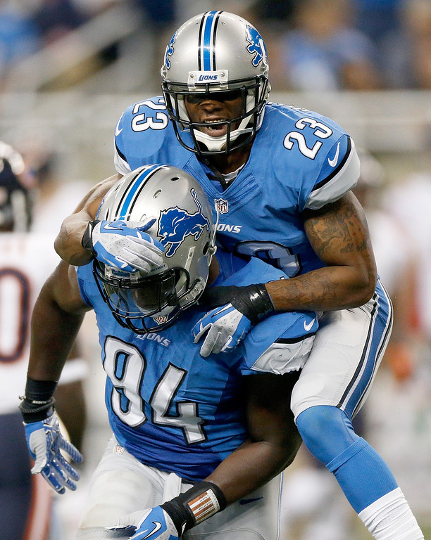 Description of . DETROIT, MI - SEPTEMBER 29:  Chris Houston #23 and Ezekiel Ansah #94 of the Detroit Lions celebrate while playing the Chicago Bears at Ford Field on September 29, 2013 in Detroit, Michigan. (Photo by Gregory Shamus/Getty Images)