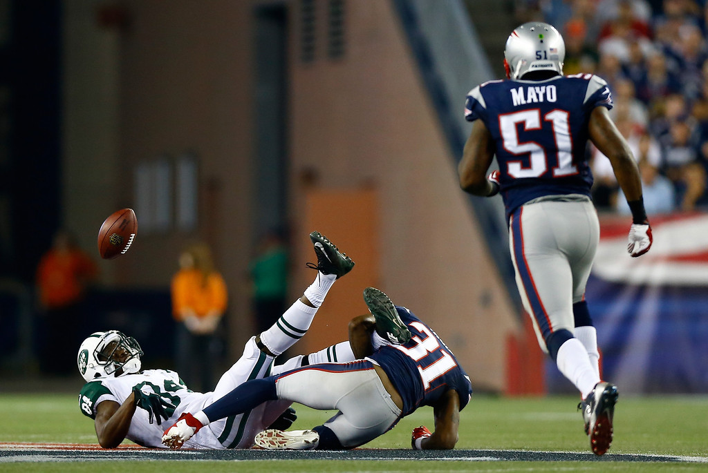Description of . Wide receiver Stephen Hill #84 of the New York Jets fumbles in the first quarter as he is hit by cornerback Aqib Talib #31 of the New England Patriots at Gillette Stadium on September 12, 2013 in Foxboro, Massachusetts. The patriots recovered the fumble.  (Photo by Jared Wickerham/Getty Images)