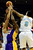 Denver Nuggets center JaVale McGee (34) and shooting guard Andre Iguodala (9) contend with Los Angeles Lakers center Jordan Hill (27) for a rebound during the second half of the Nuggets' 126-114 win at the Pepsi Center on Wednesday, December 26, 2012. AAron Ontiveroz, The Denver Post