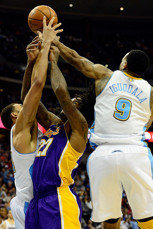 Description of . Denver Nuggets center JaVale McGee (34) and shooting guard Andre Iguodala (9) contend with Los Angeles Lakers center Jordan Hill (27) for a rebound during the second half of the Nuggets' 126-114 win at the Pepsi Center on Wednesday, December 26, 2012. AAron Ontiveroz, The Denver Post