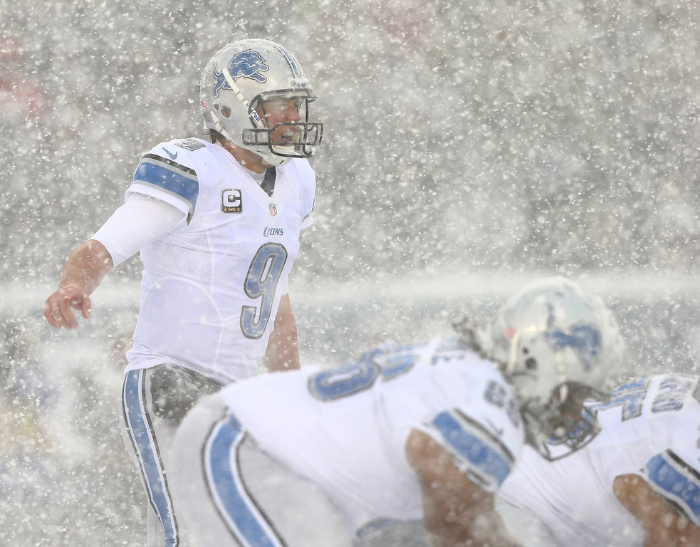 Description of . Matthew Stafford #9 of the Detroit Lions calls out the play in the first quarter against the Philadelphia Eagles  on December 8, 2013 at Lincoln Financial Field in Philadelphia, Pennslyvania.  (Photo by Elsa/Getty Images)