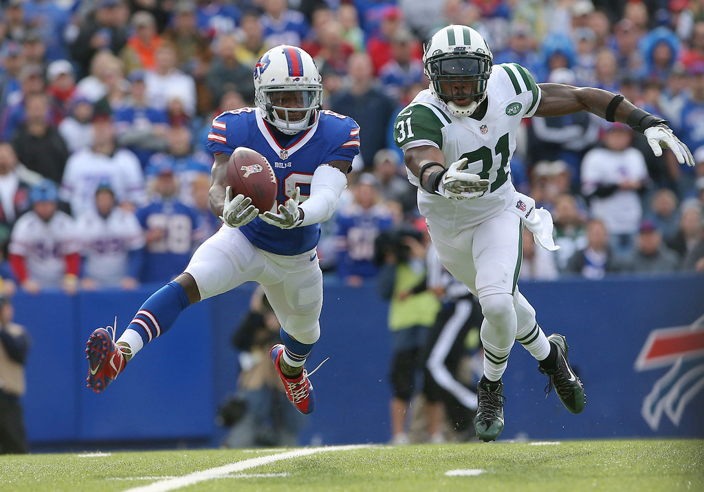 Description of . Marquise Goodwin #88 of the Buffalo Bills cannot catch a pass during NFL game action as Antonio Cromartie #31 of the New York Jets defends at Ralph Wilson Stadium on November 17, 2013 in Orchard Park, New York. (Photo by Tom Szczerbowski/Getty Images)