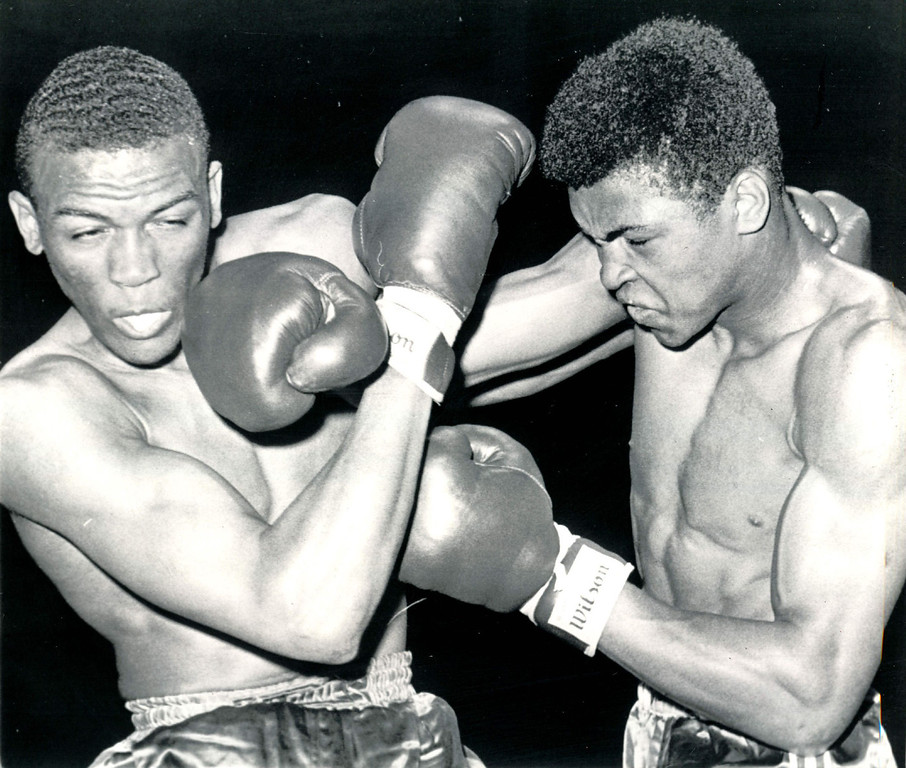 Description of . Knockout Punch Heard in Rome This is the hard right thrown by Cassius Clay (right) of Louisville, Ky., that knocked out Henry Cooper of Memphis, Tenn., in first day of Olympic Boxing Trial Finals at the San Francisco Cow Palace Wednesday night.  U.S. Olympic team chosen will go to Rome.  1960  Credit: AP