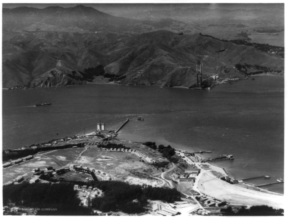 Description of . An aerial view with the Golden Gate Bridge under construction, c1934. (Photo by Chas. M. Hiller, Library of Congress)
