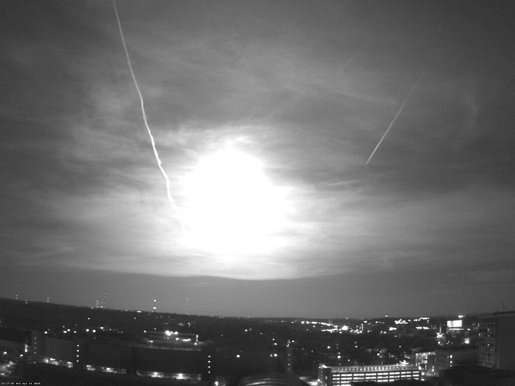 Description of . This black and white photo from a rooftop webcam released Thursday, April 15, 2010, by the University of Wisconsin-Madison Department of Atmospheric and Oceanic Sciences shows a fireball as it passed over Madison, Wis., Wednesday night. National Weather Service meteorologist David Sheets in Davenport, Iowa, says a meteor soared past about 10 p.m. local and appears to have disintegrated as it reached southwest Wisconsin. The meteor, also seen in Missouri, Illinois and Iowa, apparently didn't cause any damage. (AP Photo/University of Wisconsin-Madison Department of Atmospheric and Oceanic Sciences)