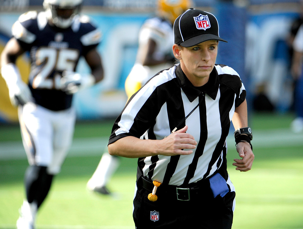Description of . In this Aug. 9, 2012 file photo, Line judge Shannon Eastin takes the field during an NFL preseason football game between the San Diego Chargers and the Green Bay Packers in San Diego. Eastin was a replacement official making her NFL debut in the exhibition game. The regular officials had been locked out by the league after their contract expired. (AP Photo/Denis Poroy, File)