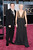 Director Quentin Tarantino and writer Lianne Spiderbaby arrive at the Oscars at Hollywood & Highland Center on February 24, 2013 in Hollywood, California.  (Photo by Jason Merritt/Getty Images)
