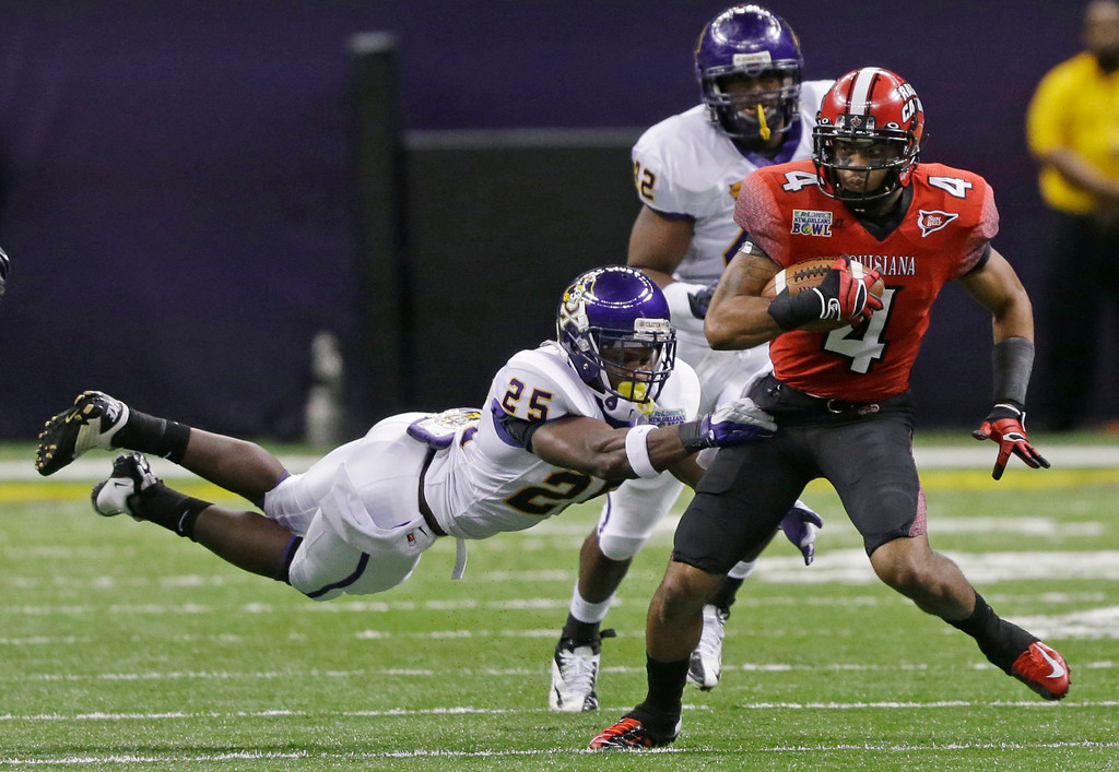 Description of . Louisiana-Lafayette wide receiver Javone Lawson (4) is chased by East Carolina defensive back Leonard Paulk (25) and linebacker Gabriel Woullard (42) in the first half of the New Orleans Bowl, an NCAA college football game in New Orleans, Saturday, Dec. 22, 2012. (AP Photo/Bill Haber)