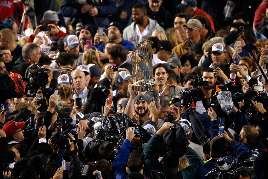 Description of . The Boston Red Sox celebrate after defeating the St. Louis Cardinals in Game Six of the 2013 World Series at Fenway Park on October 30, 2013 in Boston, Massachusetts. The Boston Red Sox defeated the St. Louis Cardinals 6-1.  (Photo by Jim Rogash/Getty Images)