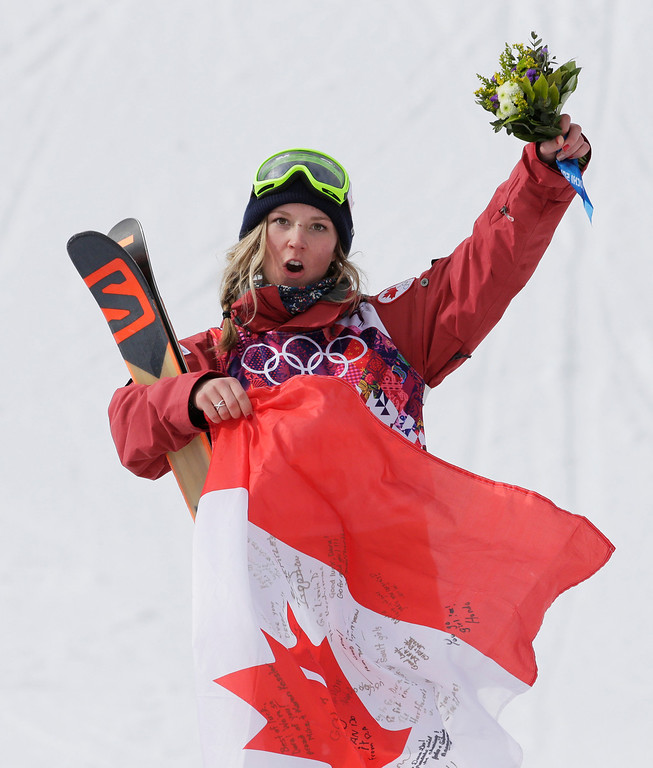 Description of . Canada\'s Dara Howell celebrates after taking the gold medal in the women\'s freestyle skiing slopestyle final at the Rosa Khutor Extreme Park at the 2014 Winter Olympics, Tuesday, Feb. 11, 2014, in Krasnaya Polyana, Russia. (AP Photo/Andy Wong)