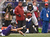 Denver Broncos wide receiver Trindon Holliday (11) just gets past a diving Baltimore Ravens wide receiver David Reed (16) as he gains a few yards during a punt return Sunday, December 16, 2012 at M&T Bank Stadium. John Leyba, The Denver Post