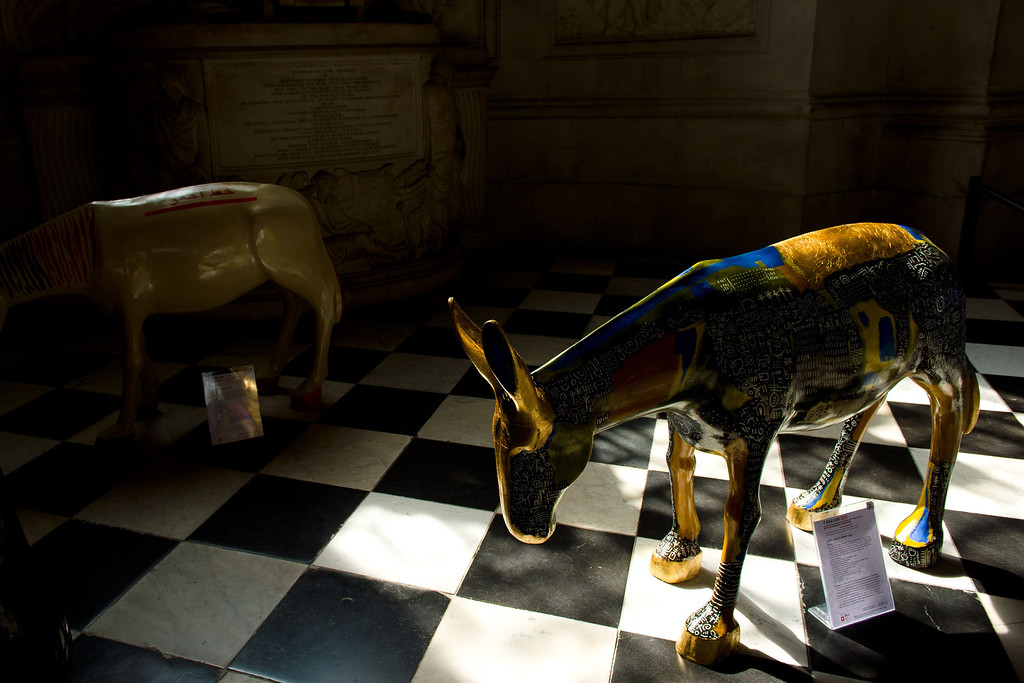 . A picture shows some of the 25 life-size painted donkeys, created by Egyptian and Western artists, as they go on display in St Paul\'s Cathedral in London on August 30, 2013.     AFP PHOTO / LEON NEAL/AFP/Getty Images