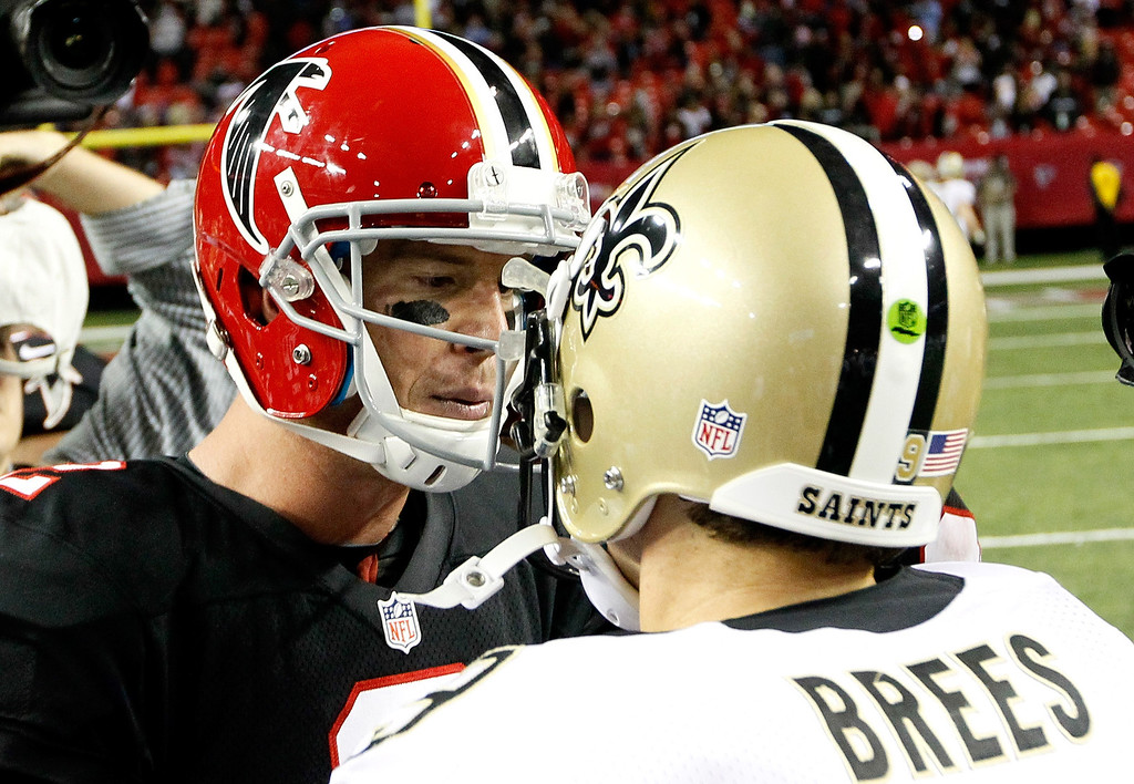 Description of . ATLANTA, GA - NOVEMBER 29:  Matt Ryan #2 of the Atlanta Falcons shakes hands with Drew Brees #9 of the New Orleans Saints after their 23-13 win at Georgia Dome on November 29, 2012 in Atlanta, Georgia.  (Photo by Kevin C. Cox/Getty Images)