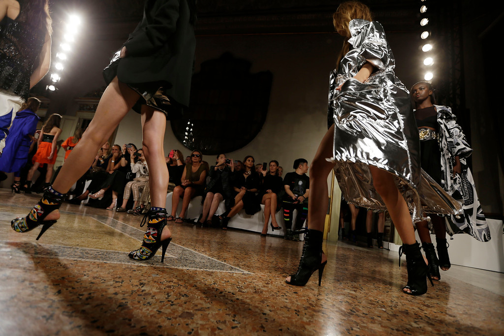 Description of . Models take the catwalk as they wear creations for Emilio Pucci women's Spring-Summer 2014 collection, part of the Milan Fashion Week, unveiled in Milan, Italy, Saturday, Sept. 21, 2013. (AP Photo/Luca Bruno)