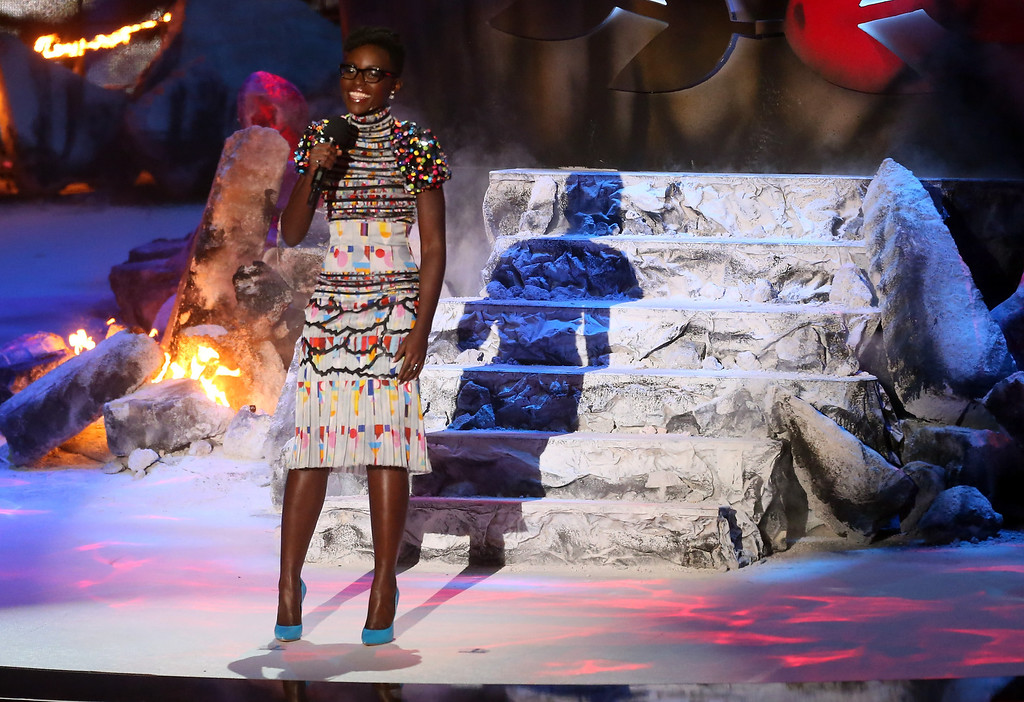 Description of . Actress Lupita Nyong'o speaks onstage at the 2014 MTV Movie Awards at Nokia Theatre L.A. Live on April 13, 2014 in Los Angeles, California.  (Photo by Frederick M. Brown/Getty Images)