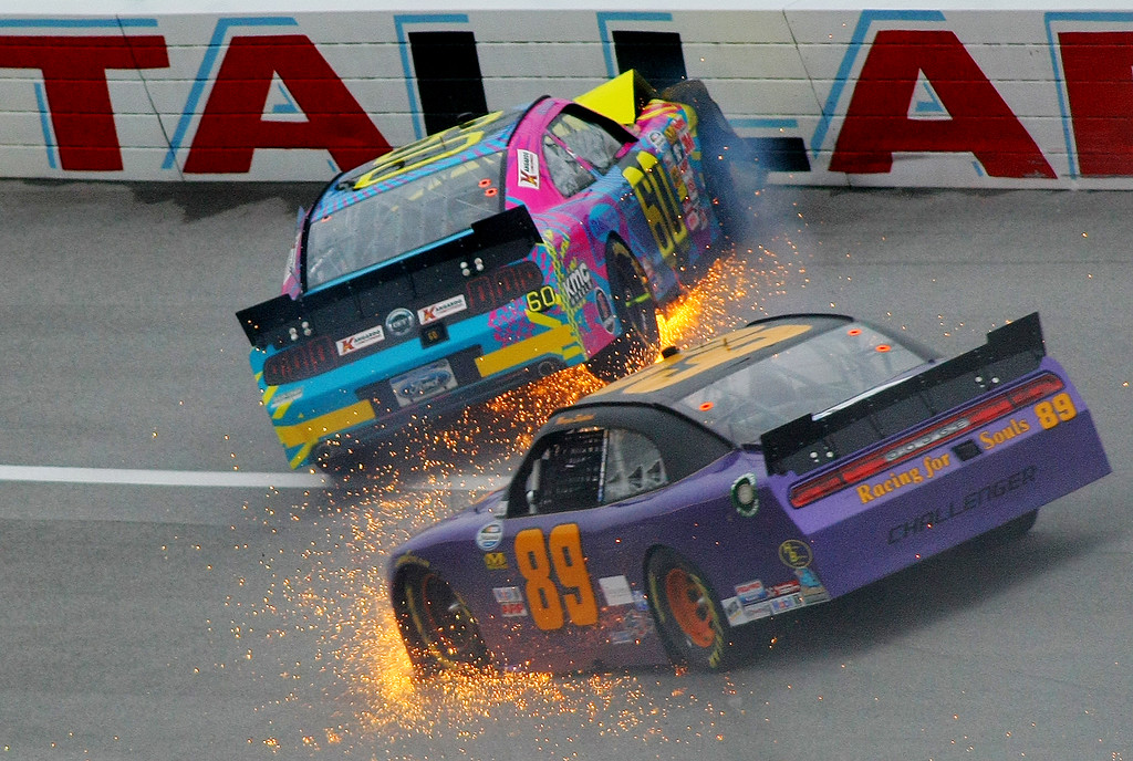 Description of . Travis Pastrana (60) crashes in Turn 3 along with Morgan Shepherd (89) during the NASCAR Nationwide Series auto race at the Talladega Superspeedway in Talladega, Ala., Saturday, May 4, 2013. (AP Photo/Greg McWilliams)