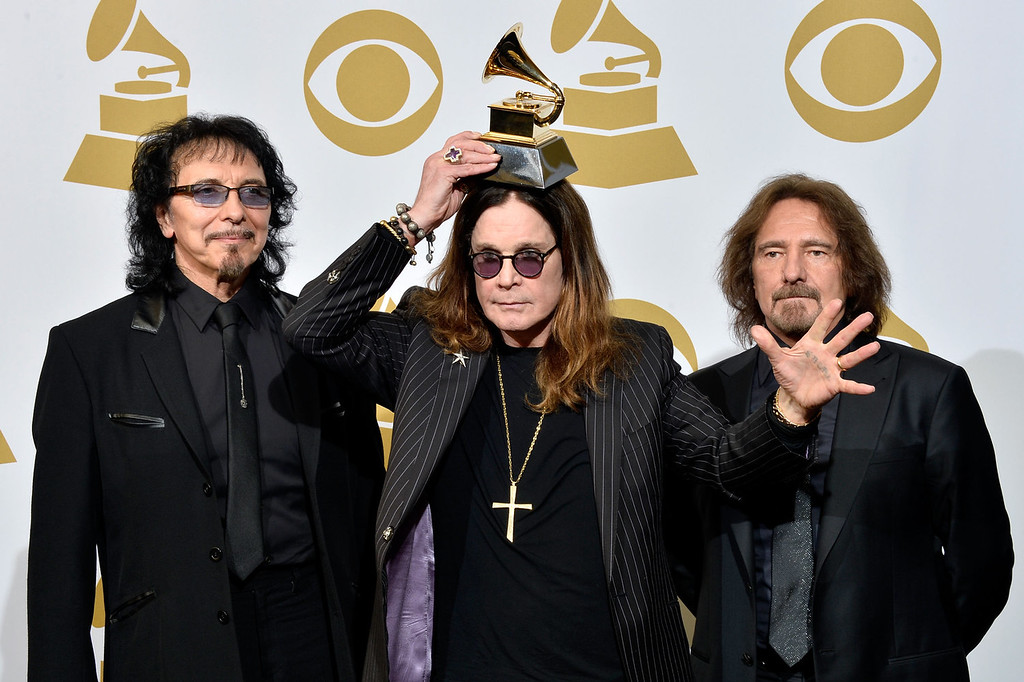 Description of . (L-R) Musicians Tony Iommi, Ozzy Osbourne and Geezer Butler of Black Sabbath, winners of Best Metal Performance for 'God Is Dead?,' pose in the press room during the 56th GRAMMY Awards at Staples Center on January 26, 2014 in Los Angeles, California.  (Photo by Frazer Harrison/Getty Images)