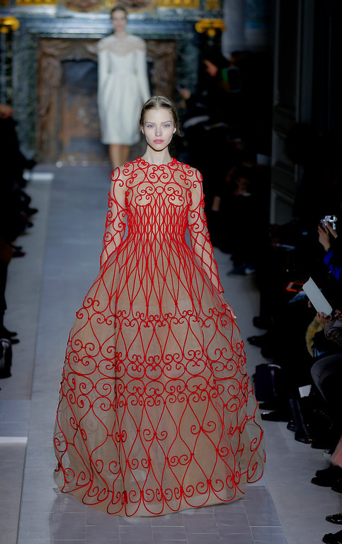 Description of . A model wears a creation by fashion designers Maria Grazia Chiuri and Pier Paolo Piccioli for Valentino as part of the Women's Spring/Summer 2013 Haute Couture fashion collection presented in Paris, Wednesday, Jan. 23 2013 (AP Photo/ Jacques Brinon)