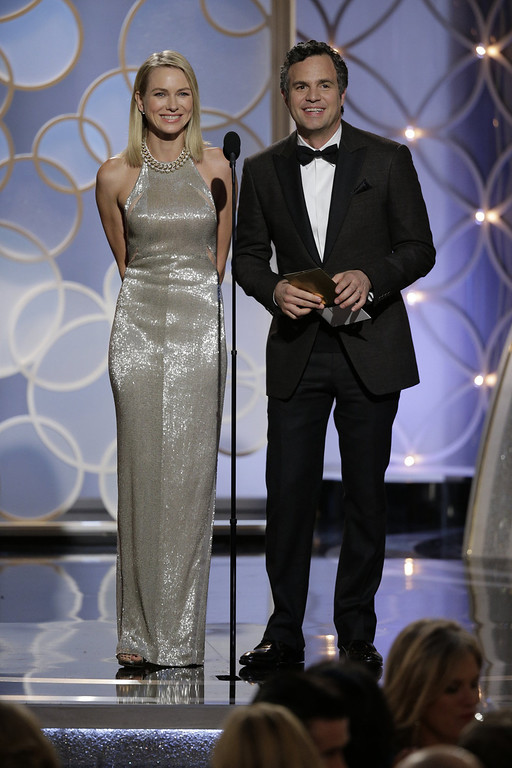 Description of . In this handout photo provided by NBCUniversal, Presenters Naomi Watts and Mark Ruffalo speak onstage during the 71st Annual Golden Globe Award at The Beverly Hilton Hotel on January 12, 2014 in Beverly Hills, California.  (Photo by Paul Drinkwater/NBCUniversal via Getty Image)