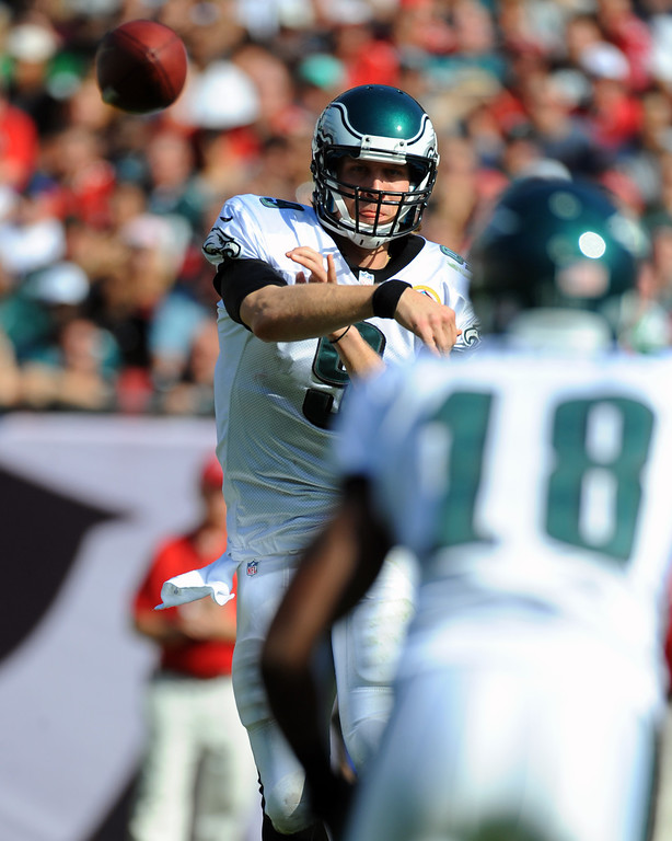 Description of . TAMPA, FL - DECEMBER 9: Quarterback Nick Foles #9 of the Philadelphia Eagles looks to pass against the Tampa Bay Buccaneers  December 9, 2012 at Raymond James Stadium in Tampa, Florida. The Eagles won 23 - 21. (Photo by Al Messerschmidt/Getty Images)