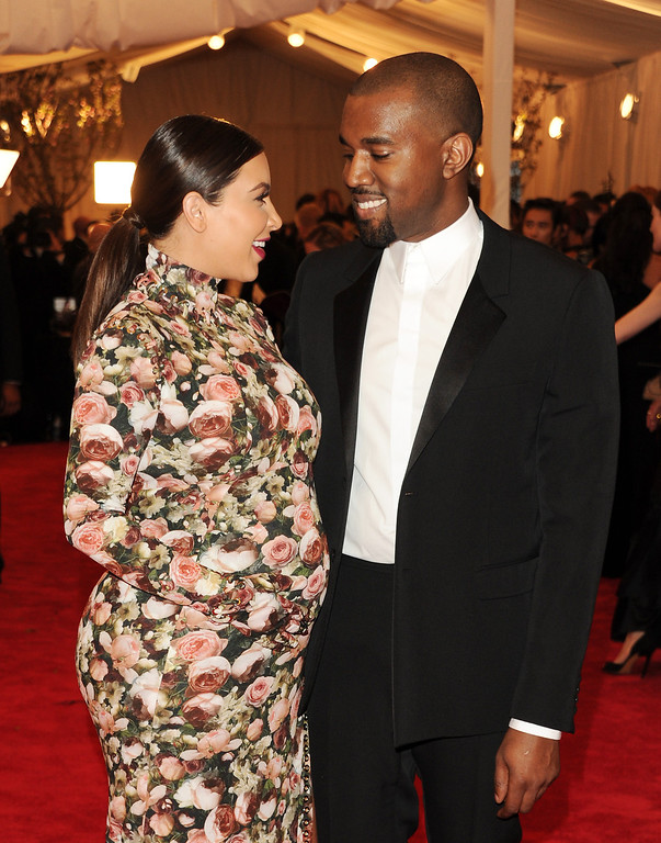 Description of . Kim Kardashian, left, and Kanye West attend The Metropolitan Museum of Art's Costume Institute benefit celebrating