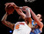 New York Knicks' Tyson Chandler (6) is fouled while shooting against Denver Nuggets' Kosta Koufus (41) during an NBA basketball game, Sunday, Dec. 9, 2012, in New York.  New York beat Denver, 112-106. (AP Photo/Jason DeCrow)