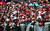 Thousands of supporters of the late Venezuelan President Hugo Chavez wait for the passage of the funeral cortege on its way to the Military Academy, on March 6, 2013, in Caracas.  AFP PHOTO/Juan  BARRETO/AFP/Getty Images