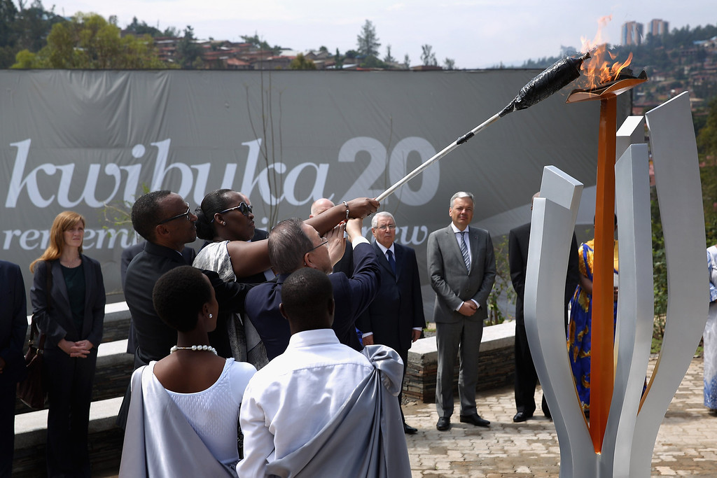 Description of . Rwanda President Paul Kagame, first lady Jeannette Kagame and UN Secretary General Ban Ki Moon light the Flame of Remembrance at the Kigali Genocide Memorial Center on April 7, 2014 in Kigali, Rwanda. (Photo by Chip Somodevilla/Getty Images)