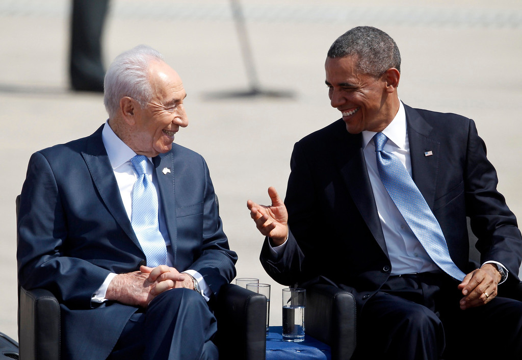 Description of . U.S. President Barack Obama (R) sits next to Israel's President Shimon Peres during an official welcoming ceremony at Ben Gurion International Airport near Tel Aviv March 20, 2013. REUTERS/Darren Whiteside