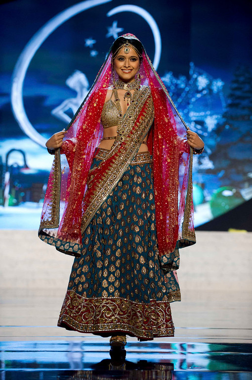Description of . Miss India Shilpa Singh performs onstage at the 2012 Miss Universe National Costume Show at PH Live in Las Vegas, Nevada December 14, 2012. The 89 Miss Universe Contestants will compete for the Diamond Nexus Crown on December 19, 2012. REUTERS/Darren Decker/Miss Universe Organization/Handout