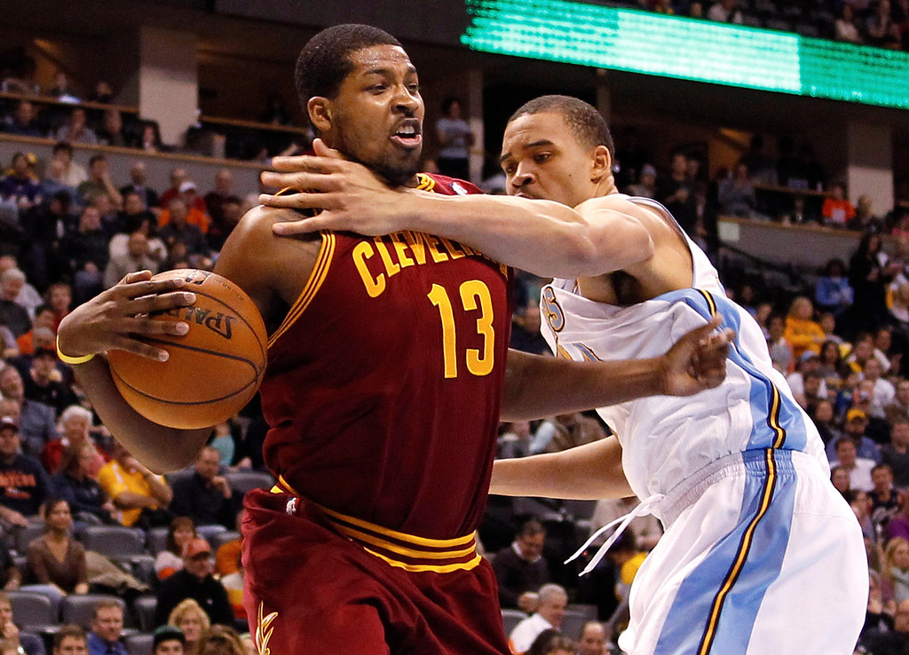 Description of . Tristan Thompson #13 of the Cleveland Cavaliers drives in the first half against JaVale McGee #34 of the Denver Nuggets at Pepsi Center on January 11, 2013 in Denver, Colorado. (Photo by Chris Chambers/Getty Images)