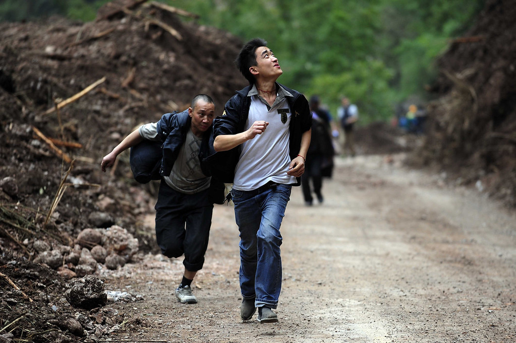Description of . People run during aftershocks to avoid falling rocks on their way to the city of Ya'an, southwest China's Sichuan province. Clogged roads, debris and landslides impeded rescuers as they battled to find survivors of a powerful earthquake in mountainous southwest China that left at least 188 dead.   STR/AFP/Getty Images