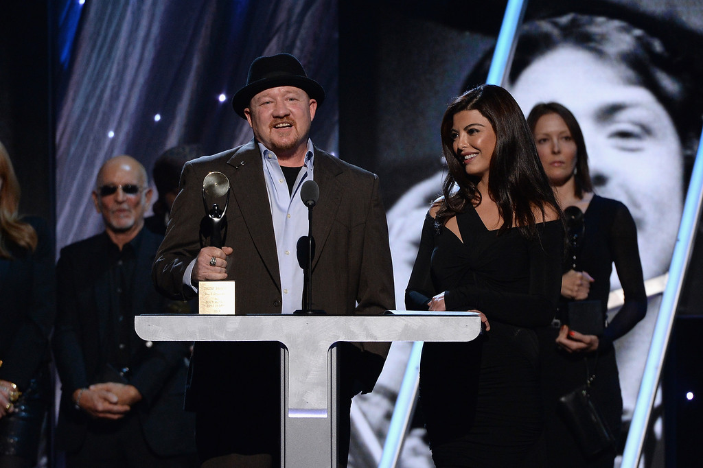Description of . Jason Federici (L) and Maya Stendahl, family of Danny Federici of the E Street Band speak onstage at the 29th Annual Rock And Roll Hall Of Fame Induction Ceremony at Barclays Center of Brooklyn on April 10, 2014 in New York City.  (Photo by Larry Busacca/Getty Images)