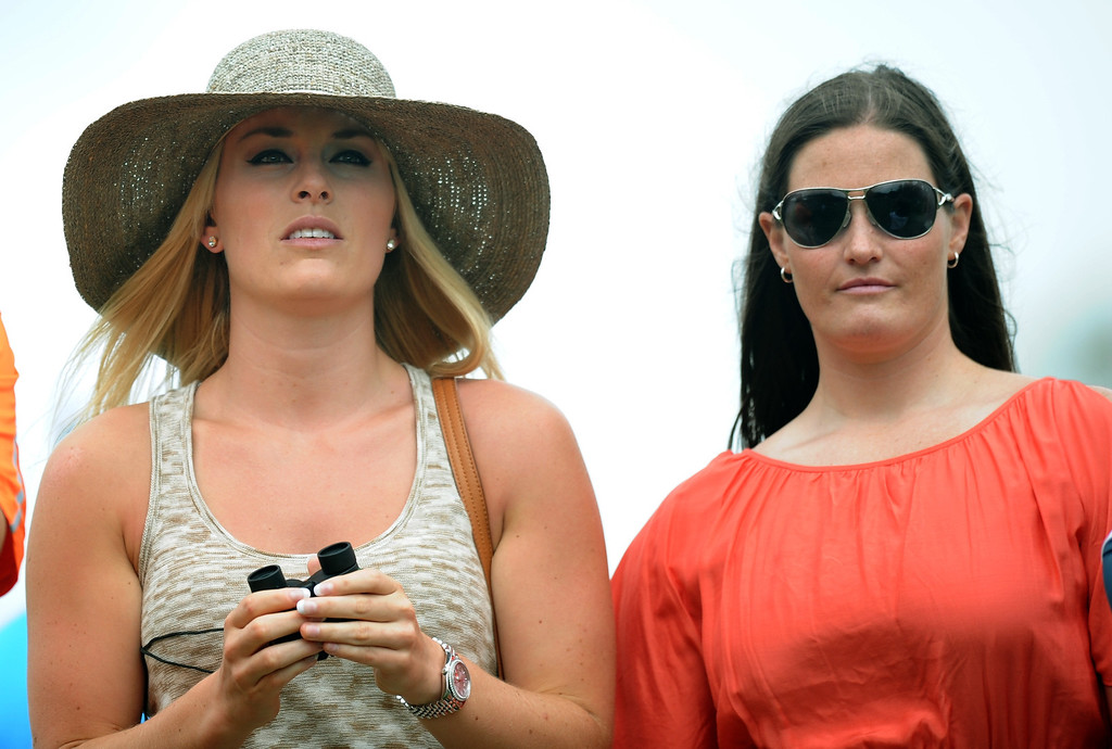 Description of . US Olympic skier Lindsey Vonn(L)  and her physical therapist Lindsay Winninger watch Tiger Woods of the US during the first round of the 77th Masters golf tournament at Augusta National Golf Club on April 11, 2013 in Augusta, Georgia.     JIM WATSON/AFP/Getty Images