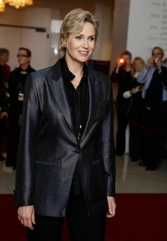 Description of . Actress Jane Lynch poses for photographers on the red carpet, before entertainer Ellen DeGeneres receives the 15th annual Mark Twain Prize for American Humor at the Kennedy Center, Monday, Oct. 22, 2012, in Washington. (AP Photo/Alex Brandon)