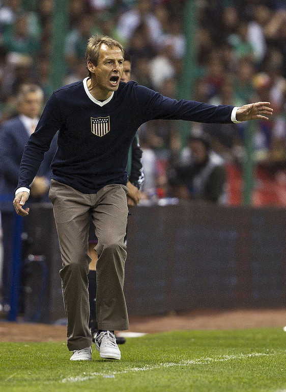 . United States coach Jurgen Klinsmann shouts instructions to his players during a World Cup 2014 qualifying match against Mexico at the Aztec stadium in Mexico City, Tuesday, March 26, 2013. (AP Photo/Christian Palma)