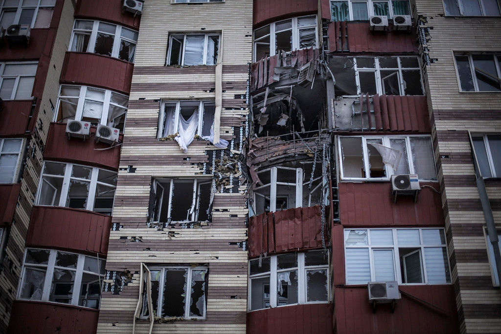Description of . A building hit by the Ukrainian Army Artillery is seen in Voroshilovsky area, center of Donetsk, Ukraine. Sunday, Jan. 18, 2015. The separatist stronghold, Donetsk, was shaken by intense outgoing and incoming artillery fire as a bitter battle raged for control over the city's airport. Streets in the city, which was home to 1 million people before unrest erupted in spring, were completely deserted and the windows of apartments in the center rattled from incessant rocket and mortar fire. (AP Photo / Manu Brabo)