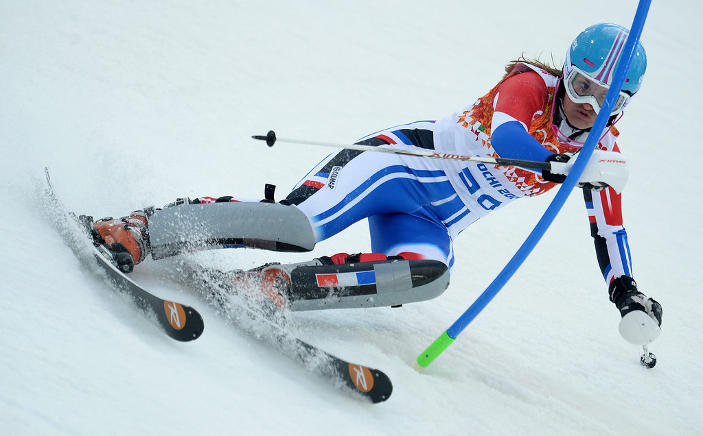 Description of . Anemone Marmottan of France in action during the first run of the Women's Slalom race at the Rosa Khutor Alpine Center during the Sochi 2014 Olympic Games, Krasnaya Polyana, Russia, 21 February 2014.  EPA/VASSIL DONEV