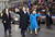 With Secret Service agents accompanying them, President Bush and first lady Laura Bush wave as they walk down Pennsylvania Avenue during the Inaugural Parade in Washington on Jan. 20, 2001. (AP Photo/Doug Mills)