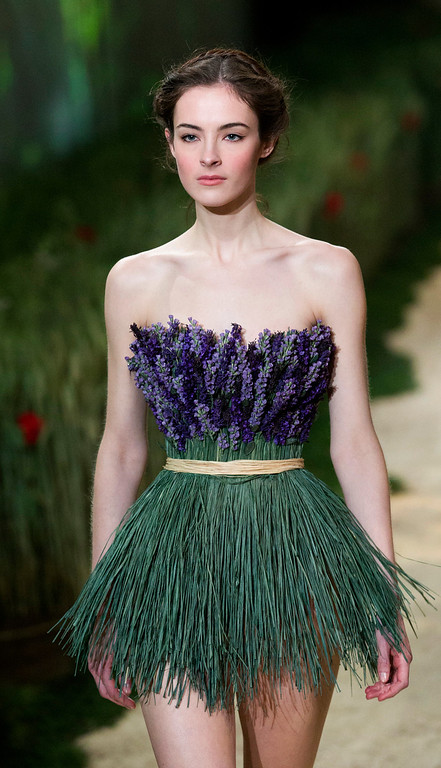 Description of . A model wears a creation by fashion designer Zahia as part of the Women's Spring/Summer 2013 Haute Couture fashion collection presented in Paris, Wednesday, Jan. 23 2013 (AP Photo/ Jacques Brinon)
