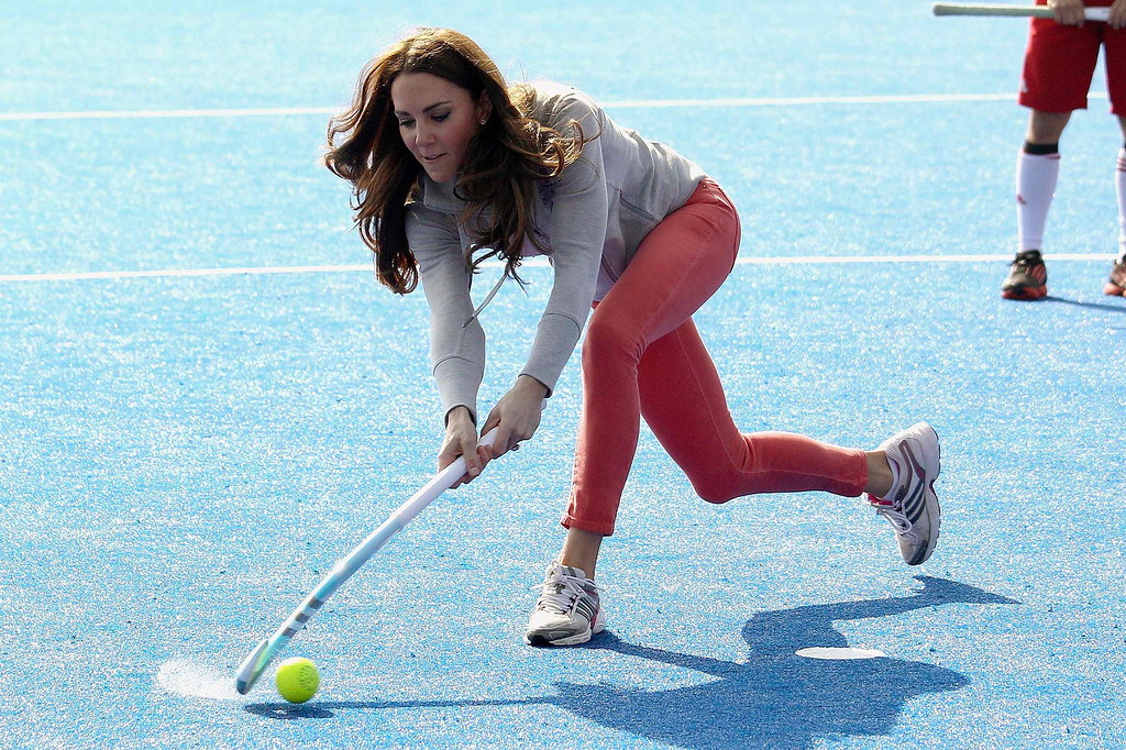 Description of . Britain's Catherine, Duchess of Cambridge plays hockey with the Team GB hockey teams at the Riverside Arena in the Olympic Park in London March 15, 2012. REUTERS/Chris Jackson/pool
